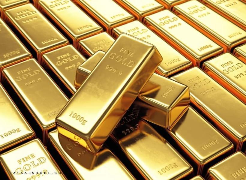 تعدادی شمش طلا روی هم قرار گرفته
